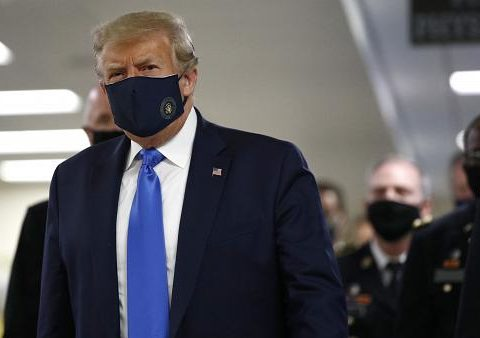 first-res Trump wears a face mask